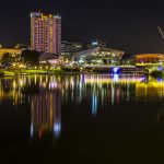 Looking down the Torrens River towards the Adelaide Entertainment Precinct at night.