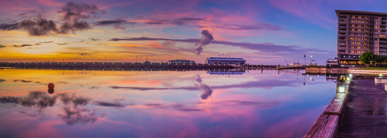 Sunrise over Darwin Waterfront, Northern Territory, Australia with reflections of Stokes Hill Wharf in the background.