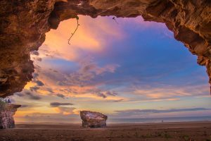 Sunset framed from a cave at the Dripstone Cliffs, Casuarina Coastal Reserve, Darwin, Northern Territory